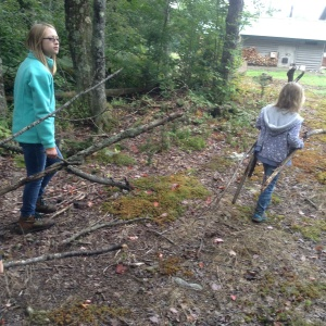 Lauren (10) and Ivy (7) found a lot of good sticks to use as poles for their lean-to